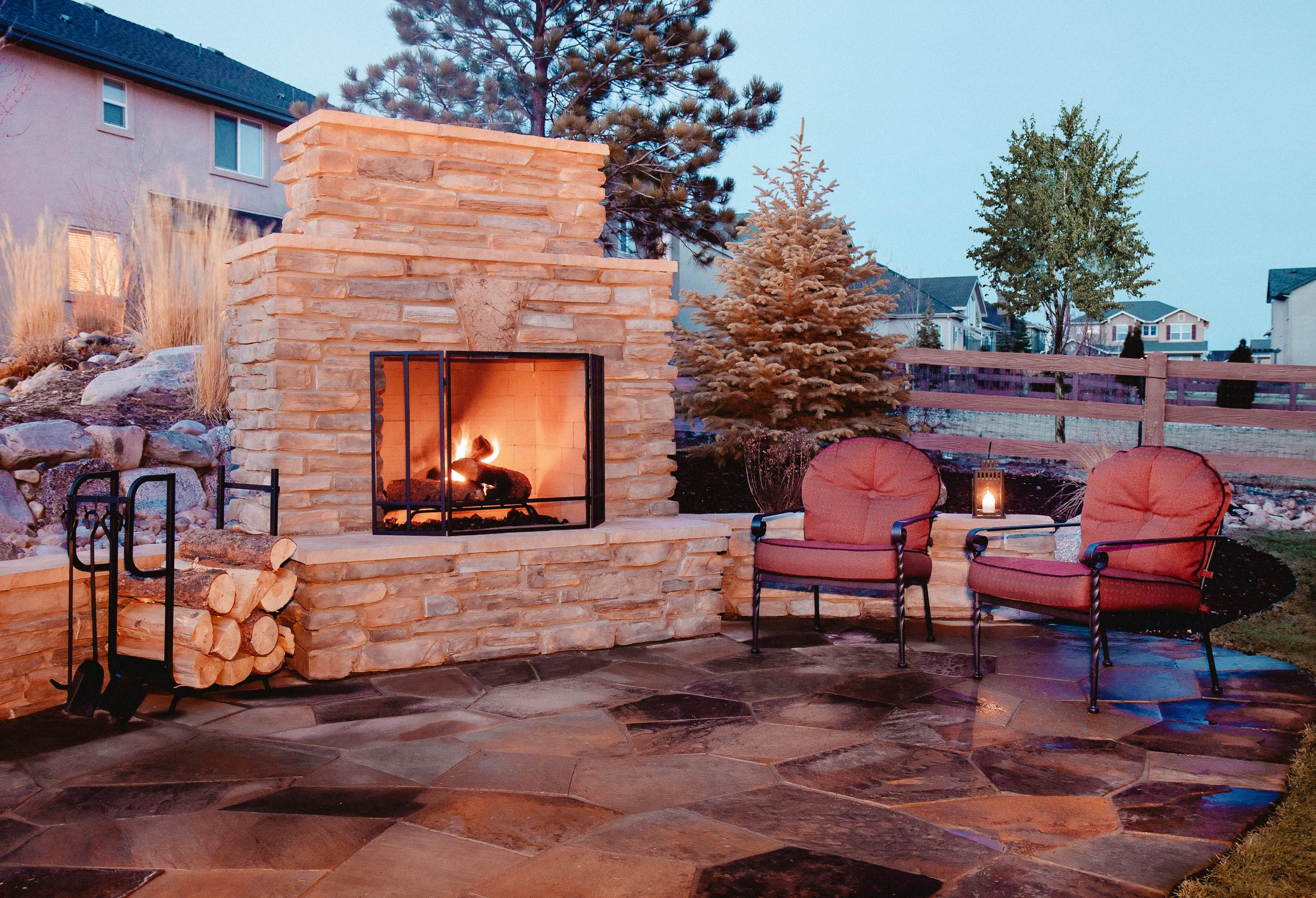 You can see an outdoor flagstone platform with fireplace, chairs
