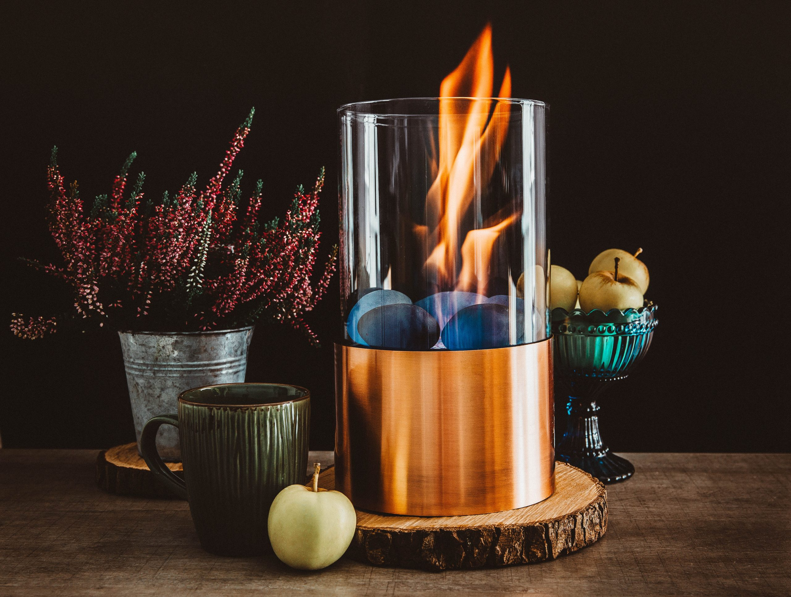 You can see a bioethanol fueled portable fireplace burning at home.