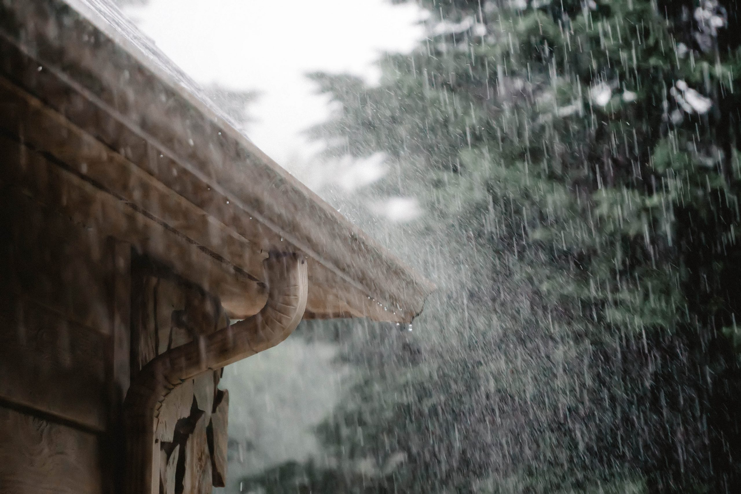 Rain falling on a roof to illustrate that screw piles can be installed in the rain.