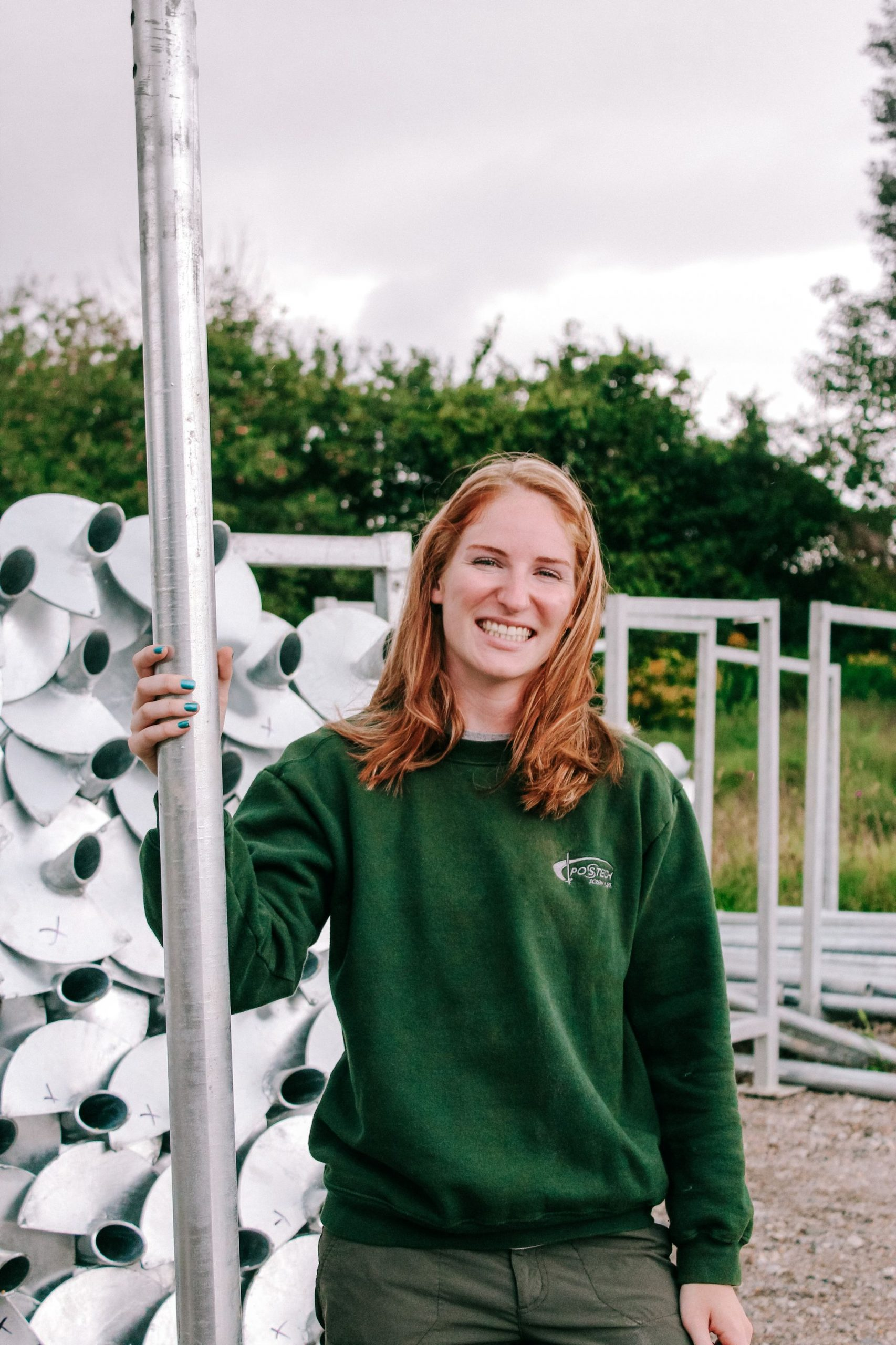 Lauren's smile is contagious as she loves coming into work every day to install Postech Piles!