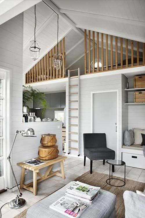 You see a mezzanine in a tiny house.