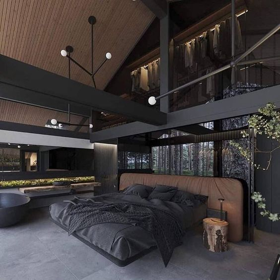 You can see a bedroom with black accents.