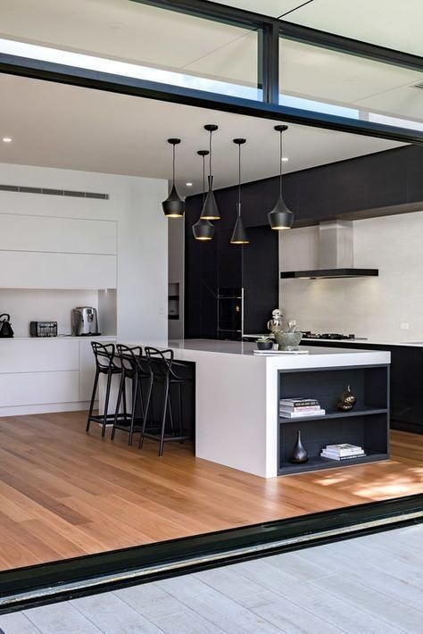 You can see a dining room with black accents.