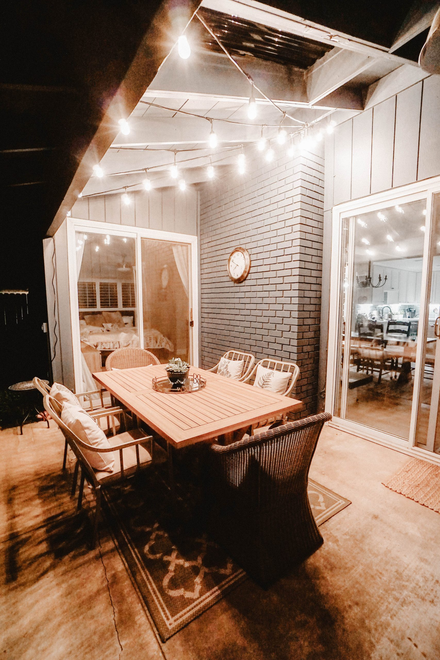 Outdoor lighting over a table on a deck