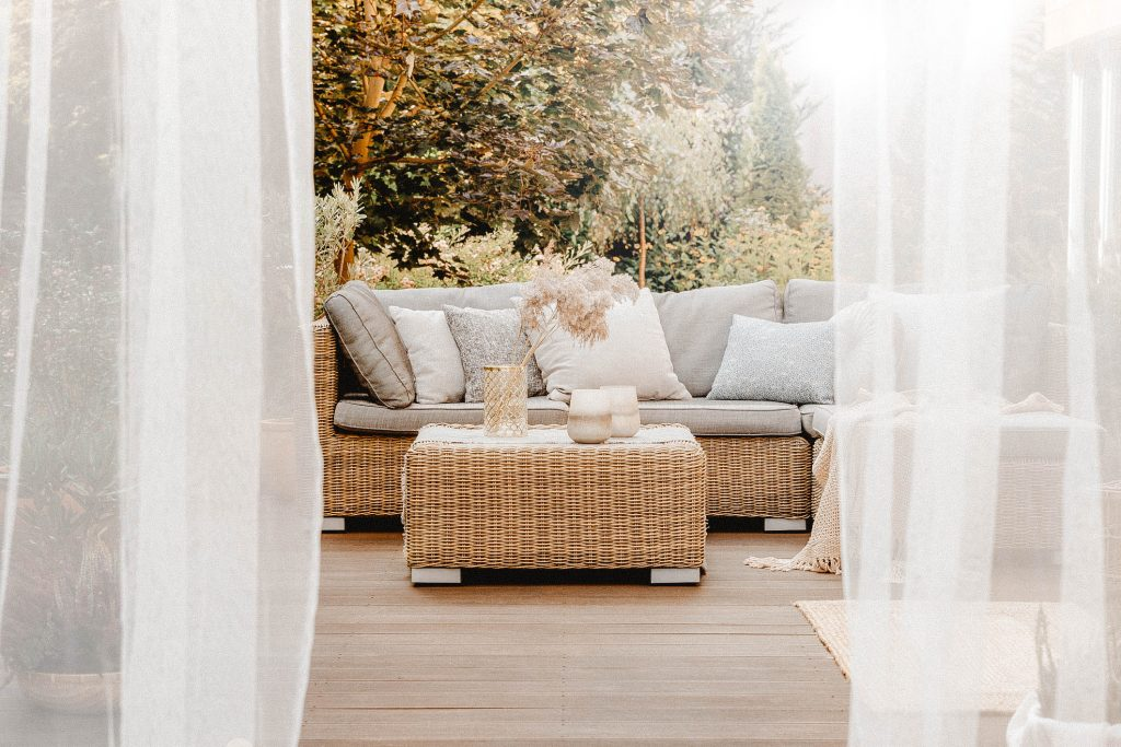 White curtains and grey couch for your deck