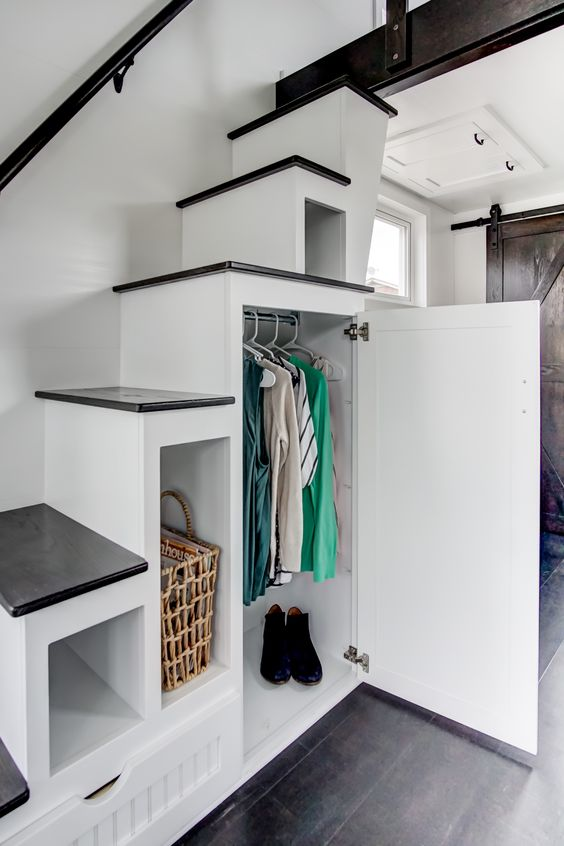 You see storage space under the stairs of a tiny house