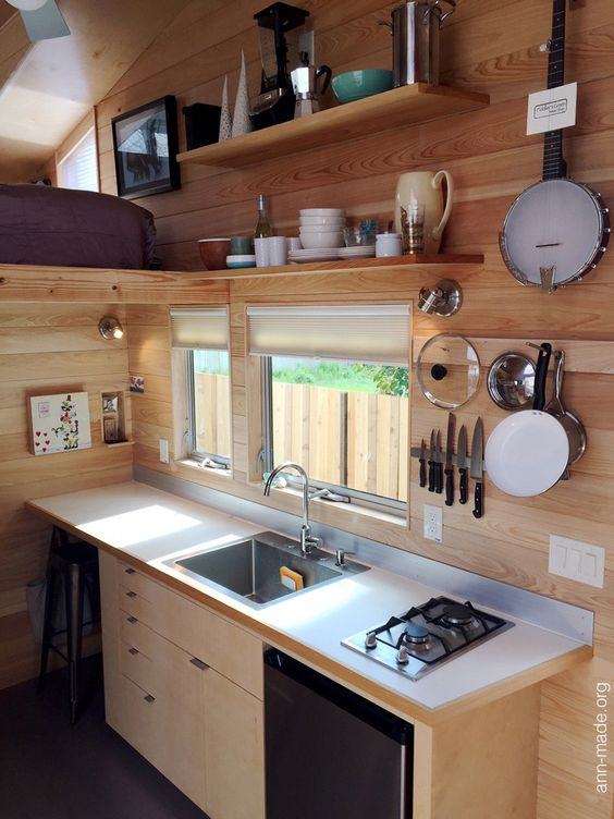 You see vertical storage in a tiny house.